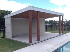 This pool cabana features Australian Hardwood Posts, Cedar Ceiling, Pine Framing, Colorbond Roof and Hardie Board Siding. Pool Gazebo, Backyard Pool Landscaping, Small Backyard Pools, Backyard Patio Designs, Swimming Pools Backyard, Backyard Pergola, Swimming Pool Designs, Backyard Cabana, Small Pool Houses