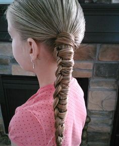 Little girls will love this simple and stylish take on the traditional ponytail. Source: Pretty Hair Is Fun