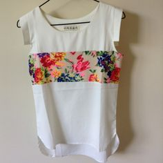 """White and Floral Blouse White blouse with strip of vibrant florals. Small sleeve. Worn once. Few tiny """"dirty"""" spots I tried to photograph in the last picture. Hardly seen but will wash or dry clean out. Fits like and XS, but no official tag size. Tops Blouses"""