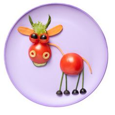 Photo: Bull made of vegetables on pink plate