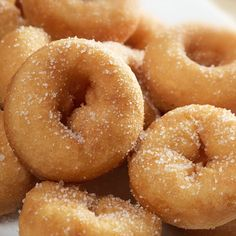 This recipe for baked mini donuts are a healthier baked version topped with a delicious cinnamon sugar dusting.. Baked Mini Donut Recipe from Grandmothers Kitchen.