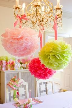 Love this idea on to hang tissue paper pom poms with ribbon (or maybe tulle?!)