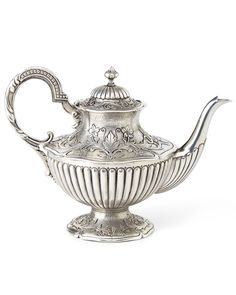 """Handcrafted teapot. Pewter. Approximately 9.25""""W x 6""""D x 6.75""""T. Imported."""