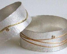 Julia Beusch Hammered sterling silver bangles with 18 carat gold details and rose cut cinnamon diamonds.