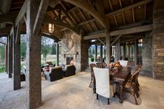 Rustic back patio with stone fireplace