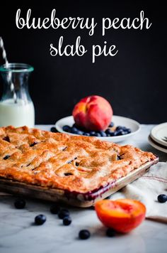 This flaky blueberry peach slab pie, packed with fresh blueberries and yellow peaches, is baked in a quarter-size baking sheet, making it easy to transport and slice, and perfect for pie crust lovers. Recipe from @BlogOverThyme