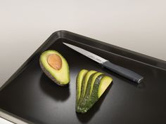 Made from stainless steel, this chopping board has non-slip feet to hold it in place. Joseph Joseph Chopping Board, Joseph's Brothers, Glass Chopping Board, Specialty Knives, Avocado Egg, Carving, Stainless Steel, Breakfast, Food