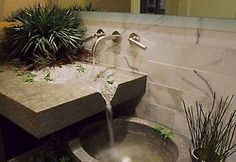 Pretty cool sink! Turn the water into a feature :)