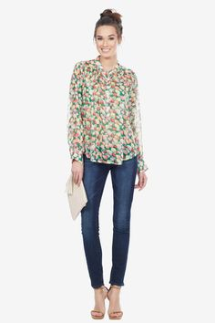 This semi-sheer blouse features an all over fruit print.