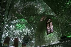 Shah Cheragh is one dazzling funerary monument. The surfaces of Shah Cheragh, a mosque in the Iranian city of Shiraz, glisten and shimmer as you walk by. Mosaics made of mirror shards and tiles cover each wall. Glittering chandeliers hang from the ceilings and spots of light dance in the domes. As the above video by Great Big Story shows, being inside is like inhabiting a disco ball.