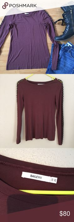 """🎉HP🎉Bailey 44 Houston Chain Sleeve Top Color is called Merlot, but looks more brown. Color closest to photos 2,3,7. Stretchy. Soft jersey top. Metal chains and faux leather down sleeves. Can see through chain. Raw unsewn hem and sleeves. Worn twice and in good condition. Some pilling throughout. A couple white marks. Coming unsewn at bottom of sleeve at seam.  Approximately 15"""" across the bust when laid flat and 24"""" from shoulder to hem.  Can fit a small more tightly as well.  Self:  94%…"""