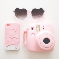 Cute phone case, glasses, and Polaroid