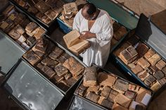 Abdel Kader Haidara, shown here at his home with storage cases full of ancient manuscripts, saved Timbuktu's priceless literary heritage from jihadists