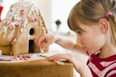 Make a Swiss Chalet Gingerbread House With This Simple Dough: Little girl making a gingerbread house