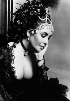 Elizabeth Taylor wearing a diadem of her own and VC&A-loaned jewels to the Proust Ball in Paris, 197