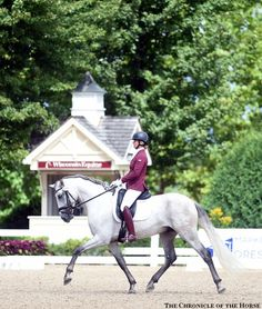 Stacey Hastings sported a burgundy coat and boots to ride Guateque IV in the 5-year-old division. Photo by Lisa Slade. Photos & Video | The Chronicle of the Horse