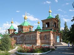 The Russian Orthodox Holy Trinity Cathedral in Karakol. It is a fine example of a Russian Orthodox Church, which served as a dance hall under the Soviets, and a school during the Second World War. Built on the site of an earlier church, erected in 1876, the current building was constructed between 1890-5. During the construction a yurt served as a church for local population.