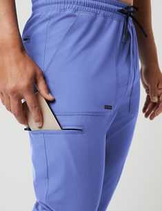 Jogger Pant in Ceil Blue is a contemporary addition to men's medical scrub outfits. Shop Jaanuu for scrubs, lab coats and other medical apparel. Scrub Suit Design, Scrub Skirts, Scrubs Outfit, Coat Pattern Sewing, Mens Designer Shirts, Medical Uniforms, Medical Scrubs, Nursing Clothes, African Men Fashion