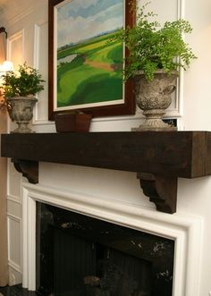 like the rustic mantel w/more formal design of the rest of the fp
