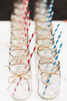 mason jars wrapped in twine with red & blue paper straws for beverage station