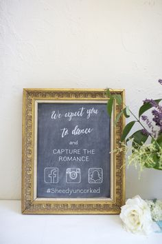 Vintage gold damask framed chalkboard as a hand painted social media sign. Capture the romance, wedding hashtag. Custom wedding signage.
