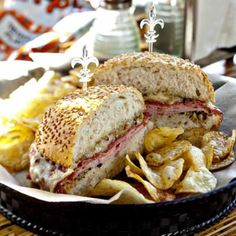 Briny garlic-and-oregano-laced olive salad, salami, mortadella, smoked ham and aged provolone in a sesame-seed-studded toasted Italian roll.