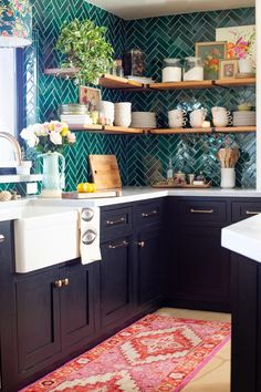 For more, visit our site. We're obsessed with the unique details of this Arizona home, like this gorgeous green tile in the kitchen and the hand painted florals on the dining room wall Click the link in our bio for a full tour! (Image & Home: Kitchen Tiles, Kitchen Decor, Kitchen Cabinets, Wall Cabinets, Ikea Black, Table Farmhouse, Laundry Room Wallpaper, Green Kitchen Wallpaper, Bohemian Kitchen