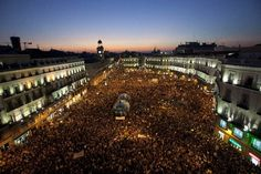 People take a part in a demostration in Puerta del Sol square in solidarity action for the worldwide protest dubbed 'Occupy the City' in Madrid on Saturday, Oct. 15, 2011. The organizers of the Occupy Wall Street campaign announced on their website that protesters will demonstrate in concert over 951 cities in 82 countries. (AP Photo/Arturo Rodriguez)