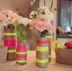 Rope Vases  Dress up simple vases and bottles to create a stunning centerpiece using rope and glue. Add neon or a splash of your favorite color for added personality!  Get the instructions from Green Wedding Shoes.