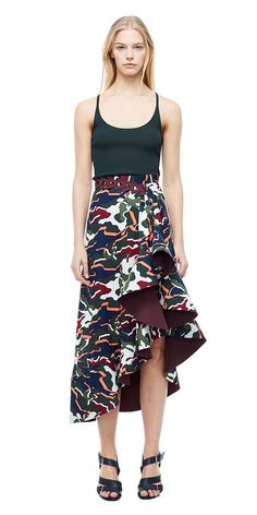 A high waisted asymmetric drape silk skirt featuring a printed camo motif. Features a contrast bonded hem finished with a baby overlock. Triangular chain belt detail at waist is a styling item only. Product Code: A1175\F17