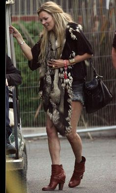 Kate Moss in one of her many boho faux fur pieces. Love!