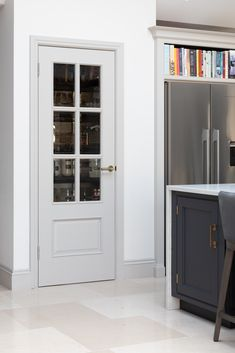 Our Longford Pantry in the Humphrey Munson showroom in Felsted, Essex has beautiful handmade cabinetry painted in a cool and calm grey colour palette. Kitchen Pantry Design, Kitchen Store, Kitchen Decor, Kitchen Ideas, Cupboard Storage, Locker Storage, House Extension Design, Open Plan Kitchen Living Room, Interior Trim