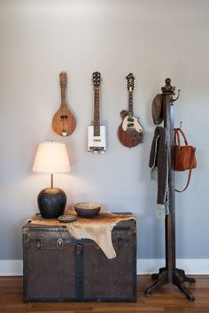 """""""This is our collection of crude string instruments. The furthest to the left was handmade in the village in Guyana where we served in the Peace Corps. The kangaroo skin and trunk belonged to Hanni's Mom when she lived in Australia in her early 20s."""""""