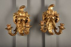 """Two  gilt wood wall lamps with two light-branches, carved in acanthus leaves and """"rocaille"""" flowers. #art #gallery"""