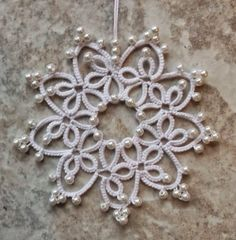 Gwen  tatted Snowflake #4 from Festive Snowflakes and Ornaments by Barbara Foster in Lizbeth size 20 white. She's using Manuel size 20 for J...