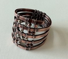 Hammered and wire wrapped ring by anikosandor Cool that it's a ring. Not my personal style, but cool nonetheless.