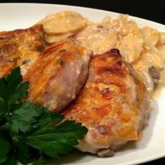 My family loves this recipe. It is easy and delicious. Pork chops are browned, then baked in a creamy mushroom sauce with potatoes, onion and cheese.