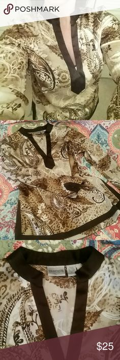 Chico's Silk Tunic Elegant 95% silk tunic in an intricate fleur-de-lis and animal print. Deep v neck, button covers on sleeves. Size 1, compares to a small.  Bundle and save! Chico's Tops Tunics