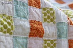 the quilt top is made by weaving fabric strips together and then sewing them down...