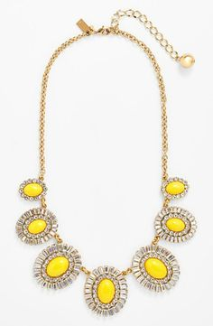 Give a neutral dress new life with a bright and sparkly yellow necklace.