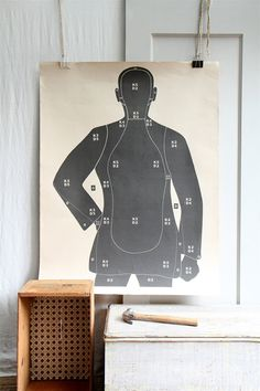 Hah! I'm so doing this. Was wondering what to do with mine from target practice. But it's a zombie print and it has actual bullet holes in it. Is that tacky?