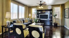 Soft yellow walls and drapes with glossy, dark wood floors and furniture—love! Las Vegas, NV