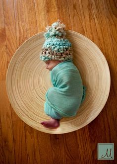 Yarn hat wrapped baby