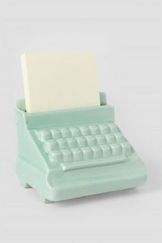 The Mint Typewriter Post It Holder is a cute post it holder that is perfect for your desk at home or at work!