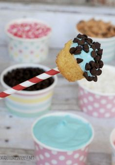 Cupcake Fondue makes for the perfect party idea! Fill cups will all your favorite candies and frostings and dip away!