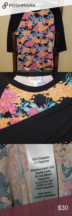 Lularoe Large Randy Baseball tee Lularoe Large Randy Baseball Tee. Worn once when first bought and has been sitting in my closet since. Please help me find a home for it! Washed per lularoe instructions and hung dry. This is soft t shirt material. 3/4 sleeves in length. Black background and black sleeves. Floral pattern with magenta, oranges, and teals in color. Smoke and pet free home. Willing to negotiate price! Original price includes tax. Cross posted. LuLaRoe Tops Tees - Long Sleeve
