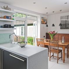 Modern kitchen with country accents - another look at the unique floating shelves.  Like the combination of modern and country!