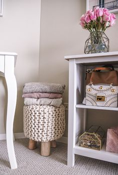An Anthropologie stool and a white bookshelf with Pinterest worthy decor. #anthropologie #interiorinspo #interiors #stool