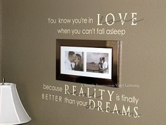 """lettering on the bedroom wall: """"You know you're in love when you can't fall asleep because reality is finally better than your dreams"""" -Dr. Seuss"""