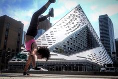 Handstand variation in front of BIG Architects Residential Building on West 57th Street New York City